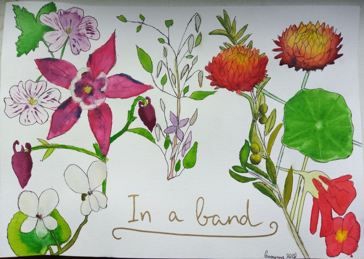 bright watercolor flowers form the outline of Spuffy
